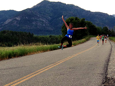 Runner jumping in the air during Star Valley Half Marathon